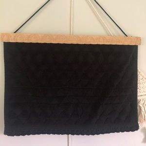 Homemade black triangle detailed wall hanging